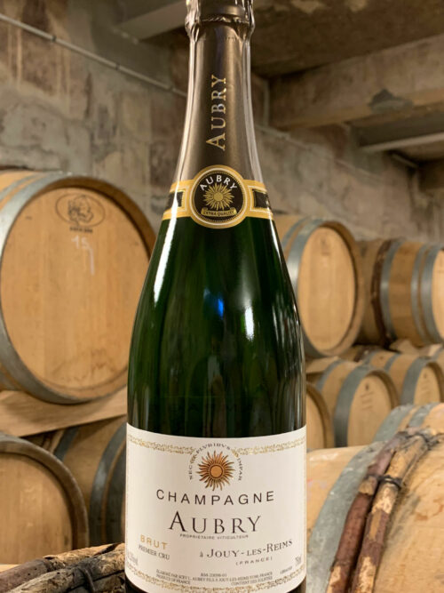 une bouteille de Champagne Aubry Brut